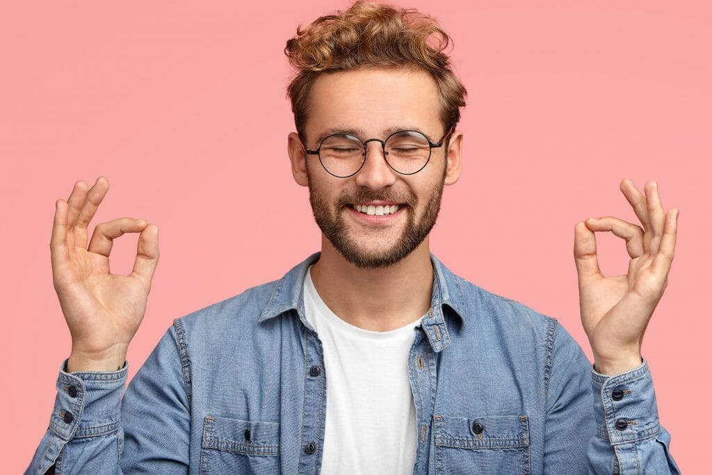short term loans used by smiling man with glasses