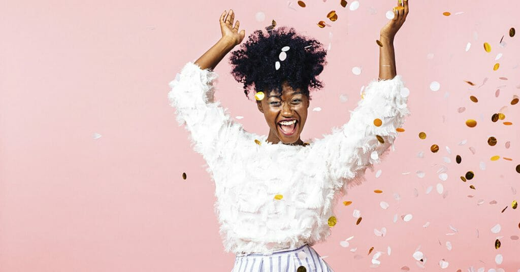 woman dancing in confetti after finding payday loans alternative