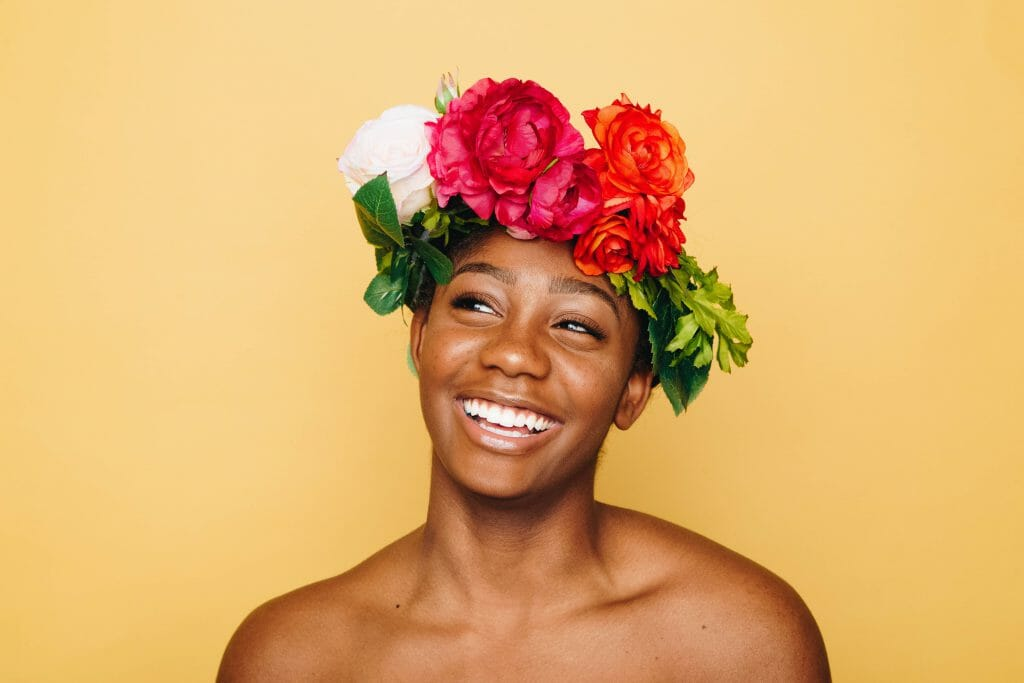 Smiling woman in flower crown thinking about quick loans