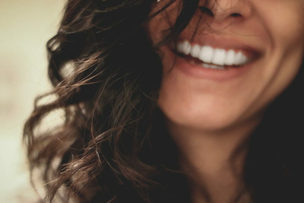 Woman smiling thinking about dental loans