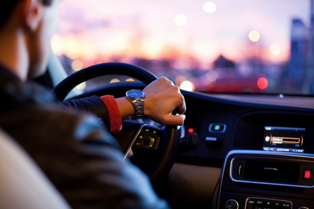 No credit check loans man driving in car with watch