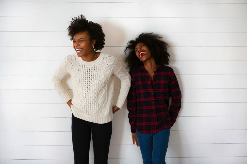 Two women laughing together about a secured personal loan
