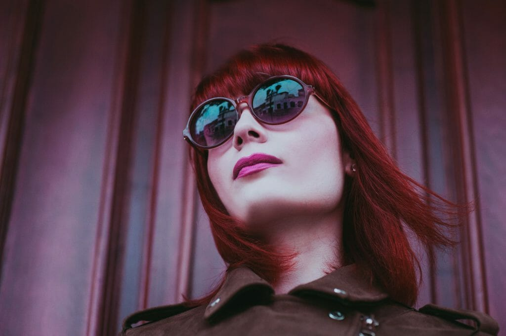 Instant cash loans reflected in woman's glasses