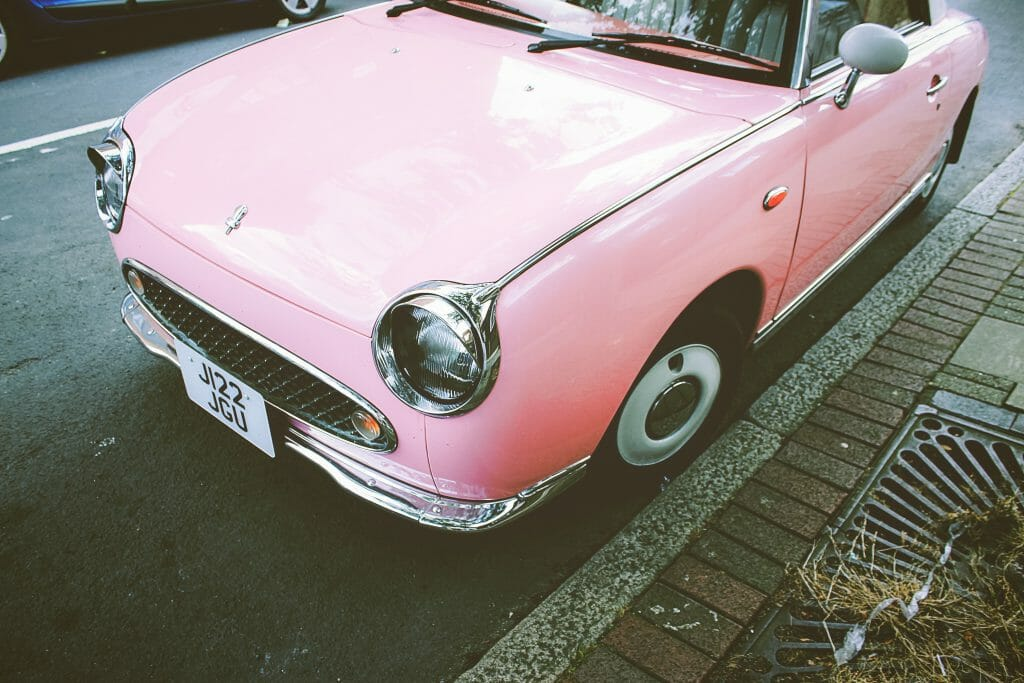 Car registration loans near me advertised near pink car
