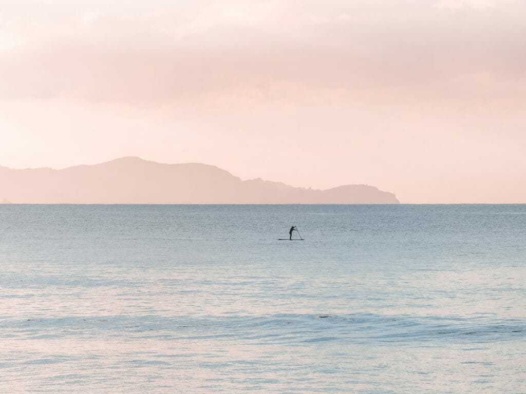 Man on paddle board thinking about quick loans no credit check same day