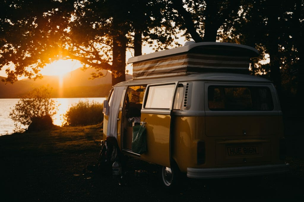 Sun setting over vehicle bought with caravan loans
