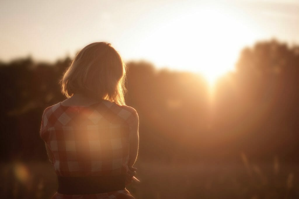 Woman looking at dawn thinking about payday loans for bankrupts