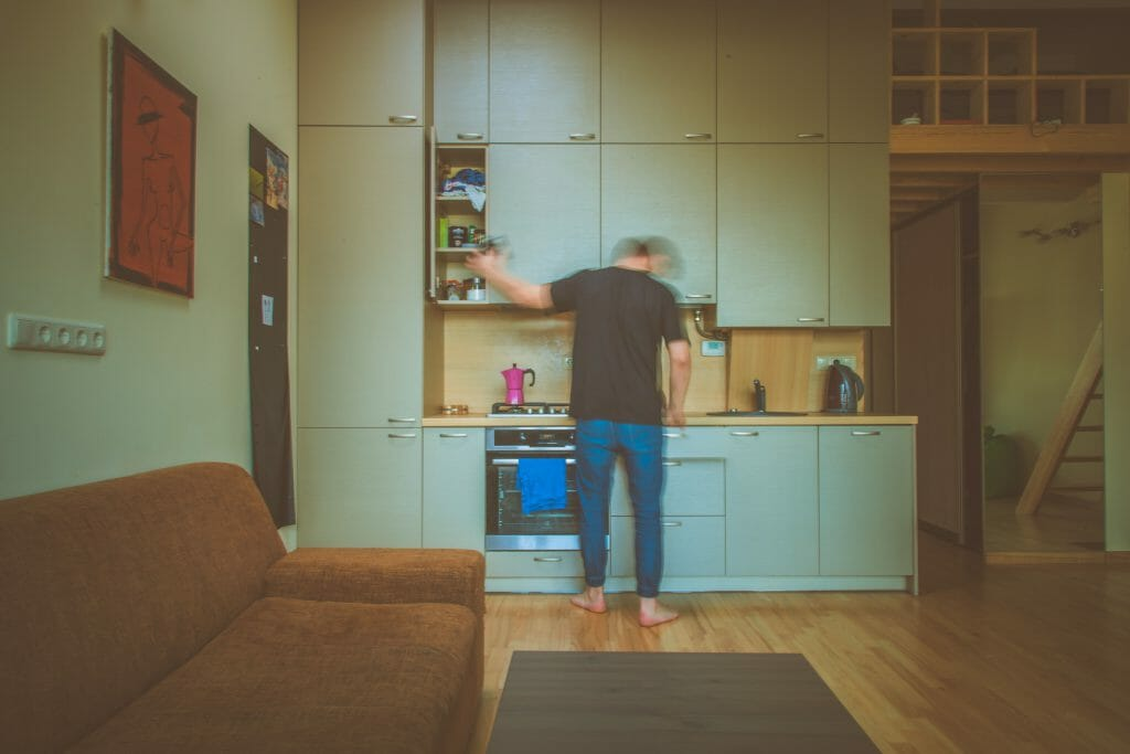 Man standing in front of oven bought with white goods loan
