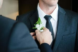 Groomsmen gifts Australia man putting flower on lapel